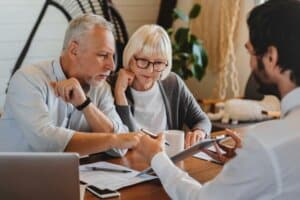 Older couple meeting with financial advisor